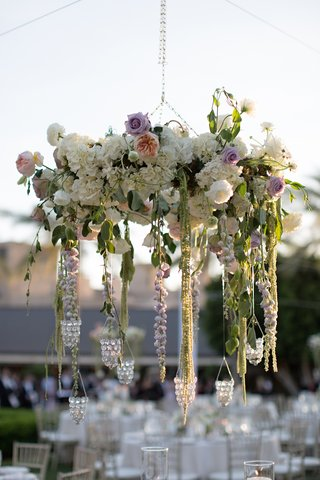 outdoor-wedding-reception-with-chandelier-made-of-white-roses-hydrangeas-and-purple-roses-peonies