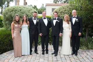 same-sex-wedding-two-grooms-with-family-and-friends