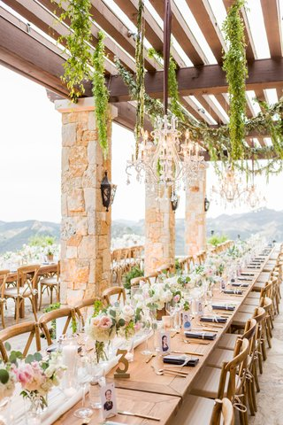 outdoor-terrace-wedding-wood-table-no-linens-runner-white-pink-flowers-greenery-cut-out-table-number