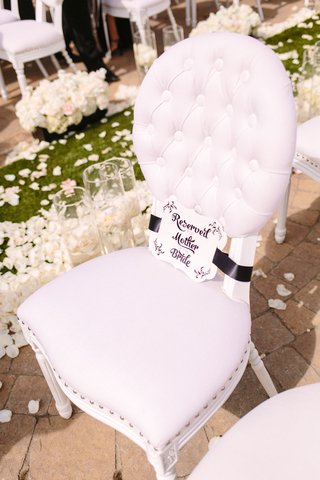 quilted-cushioned-white-chair-with-reserved-for-mother-of-the-bride-sign