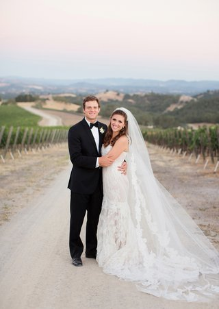 man-in-tuxedo-and-woman-in-wedding-dress-at-winery