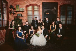 bride-and-groom-with-wedding-party-in-brick-building