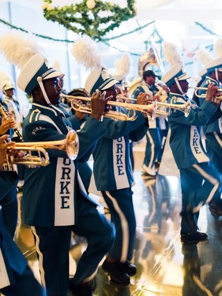 wedding-reception-surprise-entertainment-marching-band-in-blue-and-white-uniforms-on-dance-floor