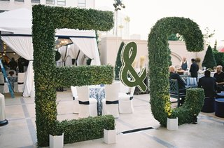 towering-initials-made-from-manicured-hedges
