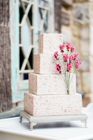 four-layer-texture-cake-design-with-square-tiers-pink-flowers-and-texture-design