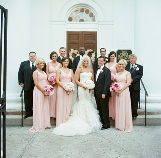 bridesmaids-and-groomsmen-outside-church