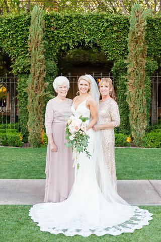 bride-in-lace-wedding-dress-with-bouquet-and-mother-of-bride-grandmother-of-bride-grandma-sparkly