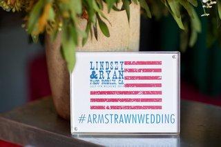 american-flag-themed-sign-displaying-wedding-hashtag