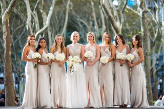 bride-in-julie-vino-wedding-dress-with-orchid-bouquet-and-bridesmaids-in-spaghetti-strap-wrap-gowns