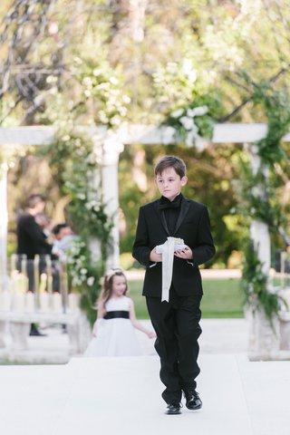 cheryl-burke-and-matthew-lawrence-wedding-ceremony-ring-bearer-in-black-tuxedo-and-black-shirt