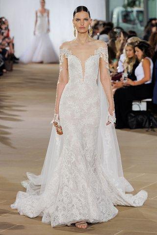 ines-di-santo-fall-2019-bridal-collection-wedding-dress-sen-off-the-shoulder-lace-trumpet-cape