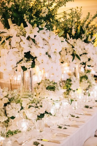 wedding-reception-long-table-antique-linen-tablecloth-white-flowers-greenery-orchids-lilies-tall