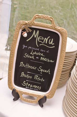 chalkboard-in-gold-tray-with-menu-in-chalk-marker
