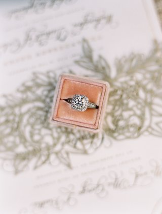 wedding-ring-in-the-mrs-box-velvet-engagement-ring-box-halo-setting-sparkling-diamond-center-stone
