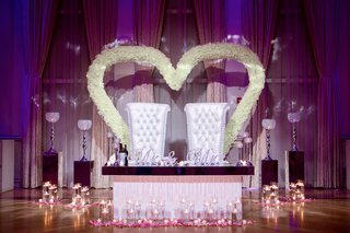 ashley-alexiss-wedding-reception-sweetheart-table-white-tufted-throne-chairs-white-flower-hearts