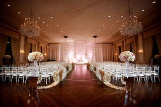 ballroom-wedding-chicago-wood-floor-flower-petal-wall-aisle-and-arrangements-chandeliers