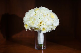 ivory-bouquet-with-ranunculus-peony-garden-rose-flowers-in-vase-white-ribbon-wrap