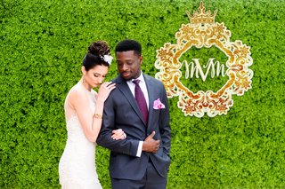 bride-in-brides-by-nona-gown-groom-in-navy-suit-and-plum-tie-interracial-bride-and-groom