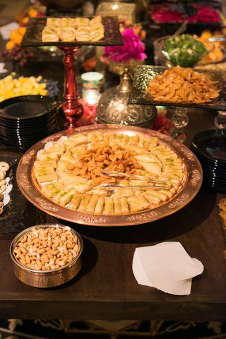 engagement-party-table-with-moroccan-food-in-metallic-platters-glass-stands
