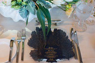 wedding-menu-card-black-menu-with-gold-lettering-and-coral-shape-detail-place-setting