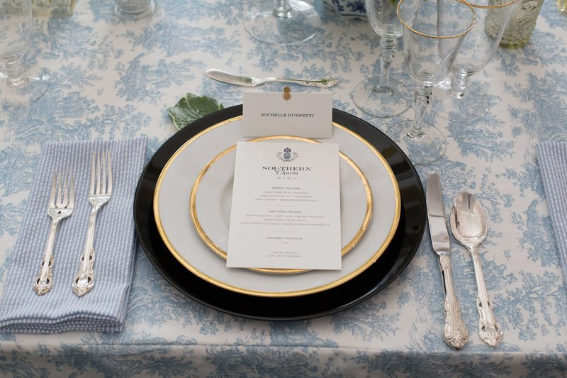 Gold-Rimmed Tableware on Blue Linen