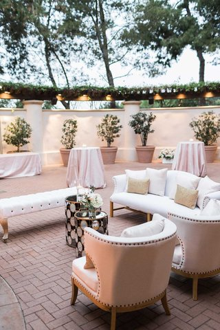 lounge-furniture-at-wedding-reception-outdoor-lounge-white-nailhead-furniture-pink-linens