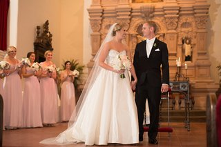 bride-in-anne-barge-ball-gown-and-veil-with-groom-in-black-tuxedo-at-brophy-chapel
