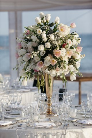 tented-wedding-reception-with-tall-centerpiece-of-white-roses-orchids-hydrangeas-pink-tulips