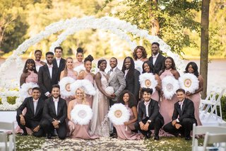 bride-and-groom-with-groomsmen-pink-ties-and-bridesmaids-dresses-gold-silver-white-feather-fans