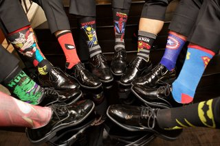 groomsmen-in-dress-shoes-and-slacks-with-superhero-theme-socks-hulk-spiderman-superman-batman-more