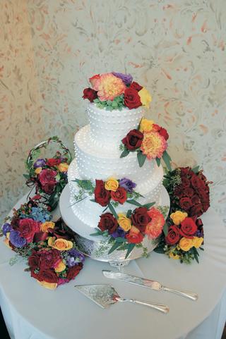 three-layer-white-cake-with-vibrant-fresh-flowers