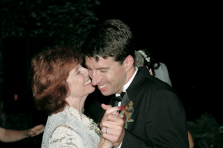 groom-dances-and-smiles-with-mother-of-the-groom