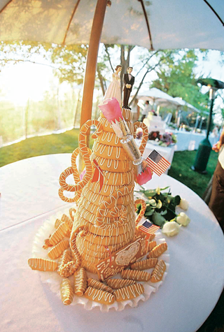 tall-coiled-wedding-cake-with-icing-and-props