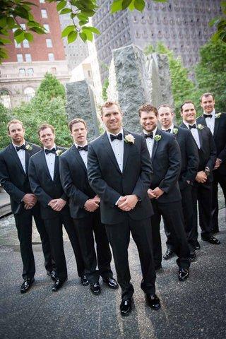 running-back-brian-leonard-in-black-tuxedo-and-rose-boutonniere-groomsmen-jordan-palmer