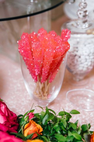 bridal-shower-dessert-hot-pink-rock-candy-at-sweets-table-white-chocolates-in-apothecary-jar-flowers