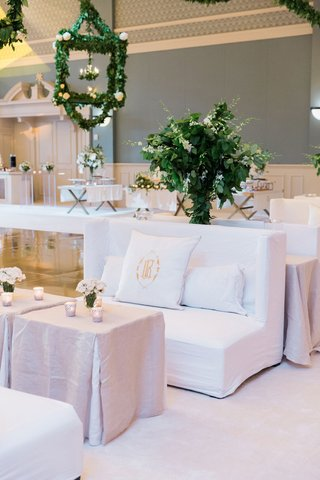 wedding-reception-lounge-space-white-lounge-furniture-table-greenery-lanterns-dance-floor