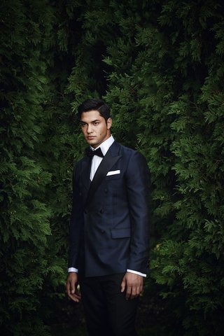 groom-in-midnight-blue-tuxedo-with-black-bow-tie