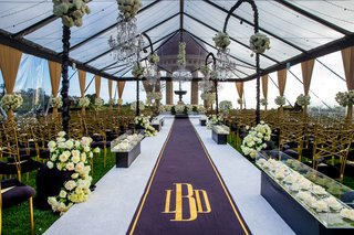 wedding-ceremony-resort-at-pelican-hill-tent-clear-with-flower-chandeliers-black-gold-aisle-runner