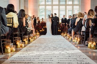 wedding-ceremony-candles-along-custom-aisle-runner-hand-written-poem-letter-candles-guests