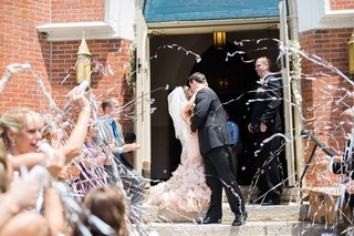 friends-and-family-launch-silver-streamers-as-newlyweds-in-vera-wang-kiss