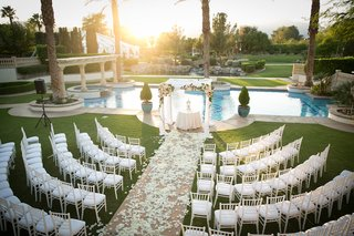 rows-of-chairs-with-view-of-chuppah-and-pool