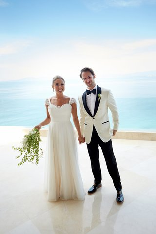 bride-and-groom-in-front-of-ocean-at-destination-wedding