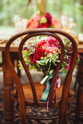 brides-bouquet-of-red-roses-pink-peonies-chamomile-blossoms-succulent-and-greenery