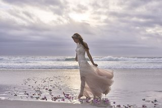 bhldn-summer-loves-wedding-dress-on-beach-at-sunset