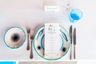 destination-wedding-in-capri-italy-place-setting-with-bright-blue-details-fish-and-sea-urchin-on