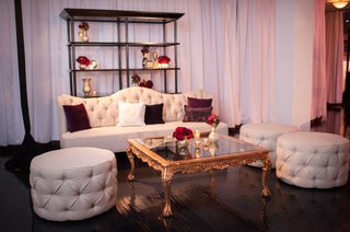 vibiana-wedding-lounge-area-with-tufted-ottoman-sofa-and-gold-coffee-table