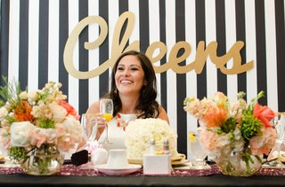 bride-with-mimosa-in-a-gold-sugar-rimmed-champagne-flute-at-bridal-shower