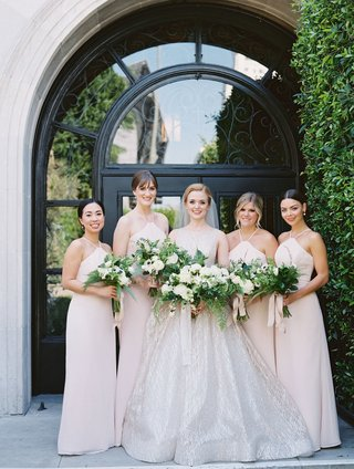 bride-in-sparkling-lazaro-wedding-dress-bridesmaids-in-hayley-paige-light-pink-halter-neck-dresses