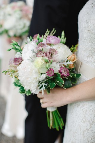 bridesmaids-bouquet-with-white-peonies-purple-blossoms-and-greenery