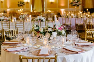 wedding-reception-ballroom-classic-decor-gold-chair-low-arrangement-greenery-white-pink-flowers